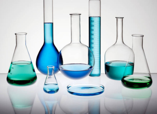 Laboratory glassware on glass table top